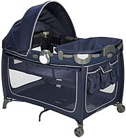 The Eddie Bauer Complete Care Playard features a bassinet, changer, toddler sleep area and play area